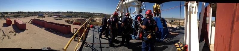 Firefighters training on an elevated portion of the drill tower